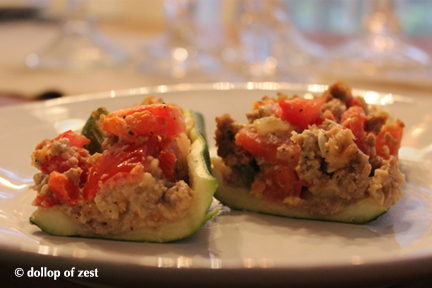 zucchini stuffed with turkey meat on a plate