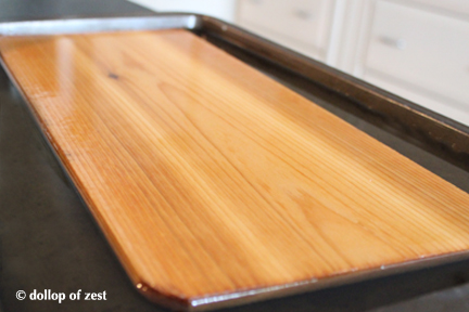 cedar board in water for grilled salmon with dill marinade & sauce