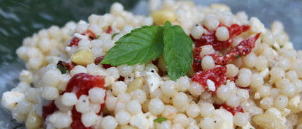 israeli couscous salad with feta, roasted red peppers and mint