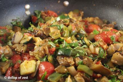 mixing in pan with basil Ratatouille