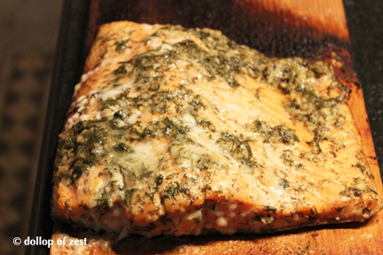 salmon cooked on the board for grilled salmon with dill marinade & sauce