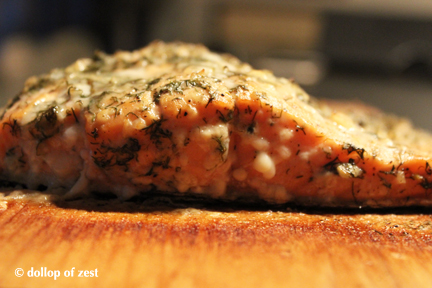 salmon side view on the board for grilled salmon with dill marinade & sauce