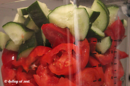 cucumbers tomatoes red pepper in blender for gazpacho with a seville twist
