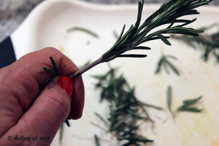 removing leaves for rosemary for rosemary roasted butternut squash