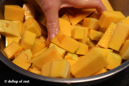tossing squash with oil for butternut squash soup