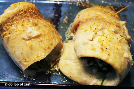 fish cooked in pan for baked fish stuffed with spinach & feta