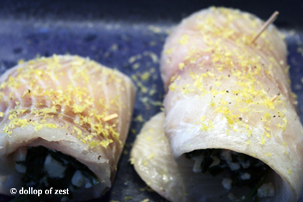 fish raw in pan for baked fish stuffed with spinach & feta