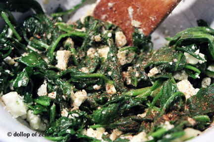 mixed spinach feta and spices for baked fish stuffed with spinach & feta