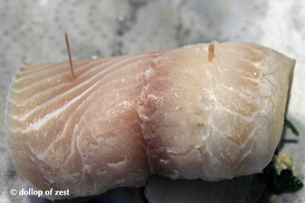 raw fish with toothpicks for baked fish stuffed with spinach & feta